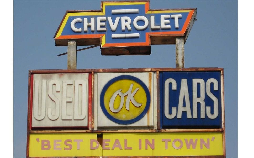 vintage used cars sign