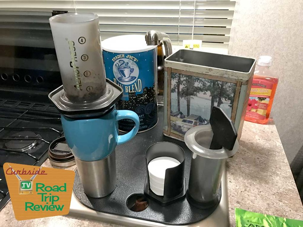 The Aeropress coffee maker along with its associated filters.