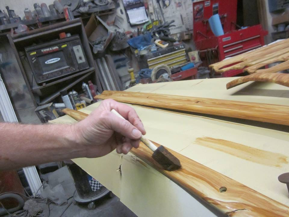 Marvin Cox applying customized woodgrain to the wagon trim