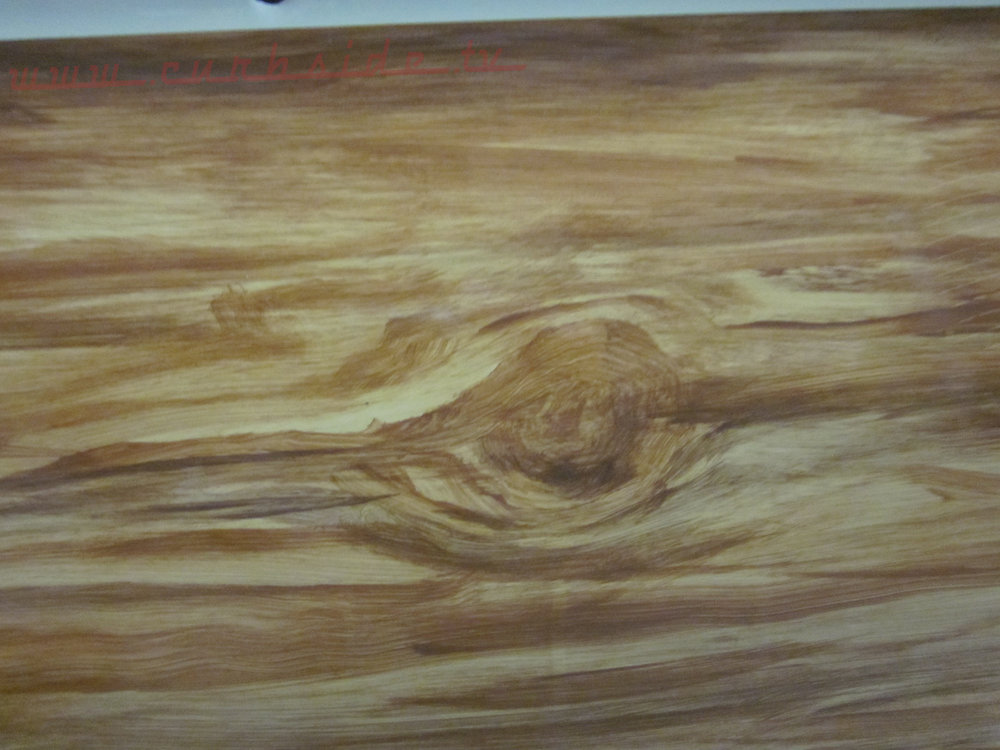 Close-up of Marvin's woodgraining