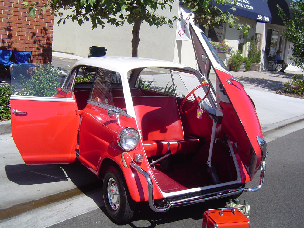 A later Isetta where the BMW added a rear seat to the car to increase its appeal as a family cruiser. Note the lack of a sunroof due to there being a single forward-hinged rear door.