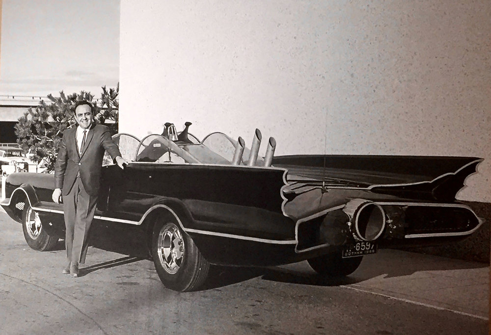 George Barris and the 1966 Batmobile he created from a Lincoln Futura show car.