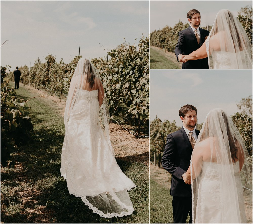 Bride walking through the vineyards to first look with her groom