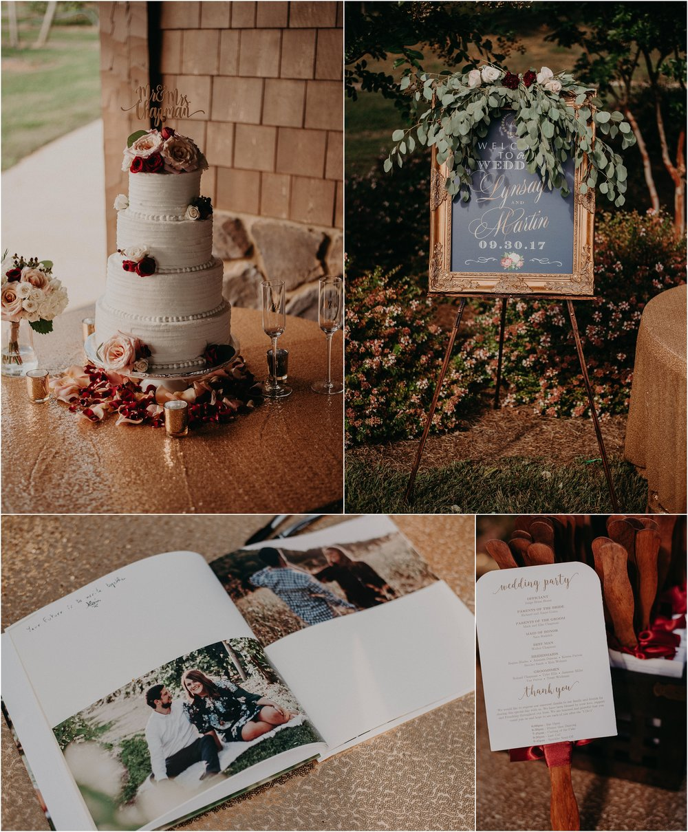 Wedding cake, registry book, program fans, and wedding welcome sign at winery wedding