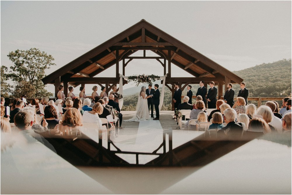Fine art wedding ceremony image with reflection of deck arbor