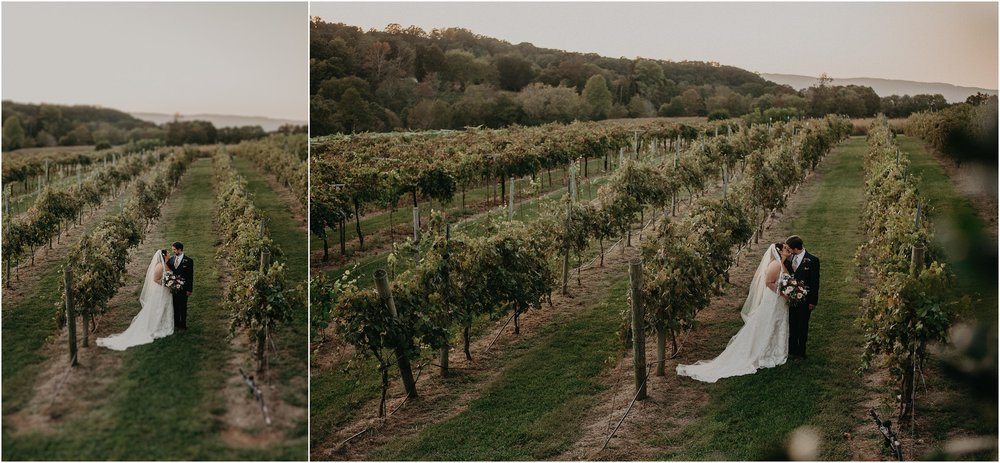 Bride and groom share a kiss in Debarge Winery vineyards