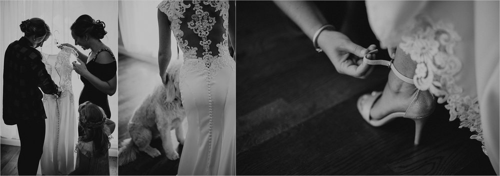 Bride gets dressed with help from her sister, her niece, and her goldendoodle dog