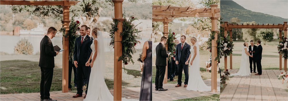 Bride and groom hold hands at altar