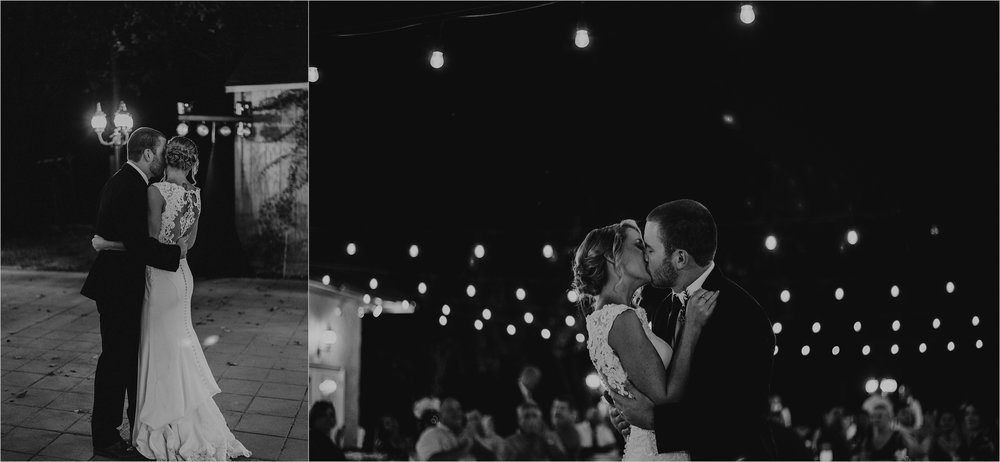 Bride and groom first dance beneath bistro lights at outdoor reception