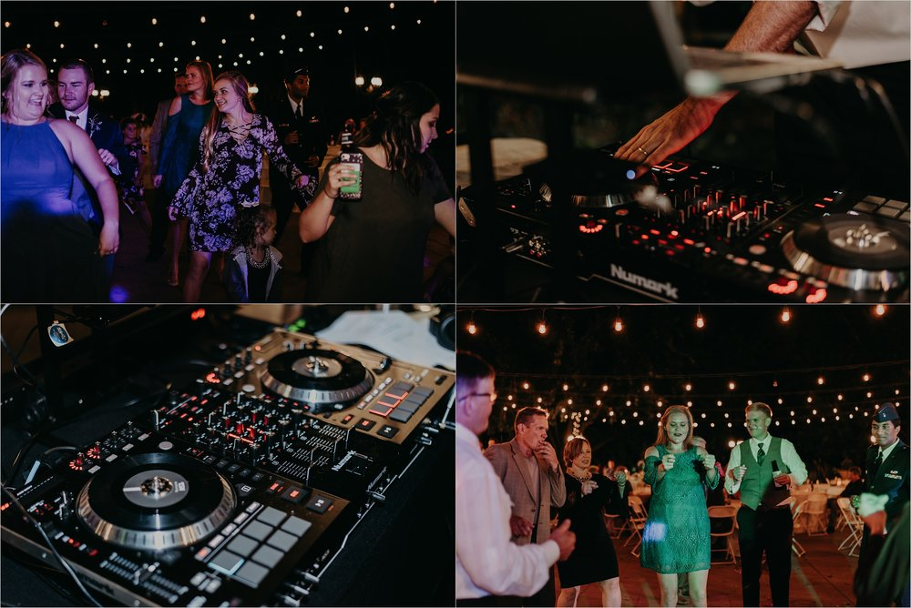 DJ setup and guests dancing at wedding reception