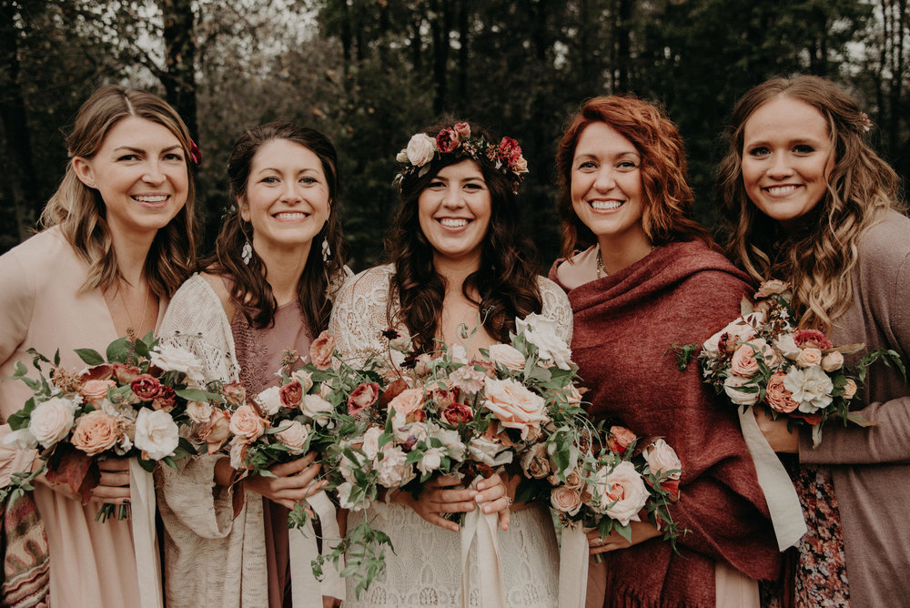 Bohemian bridal party wrapped in shawls and kimonos to keep warm at wedding at Crabtree Farms in Chattanooga, Tennessee
