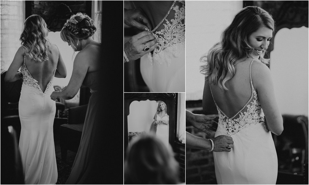 Mother of the bride helps her daughter get dressed on her wedding day