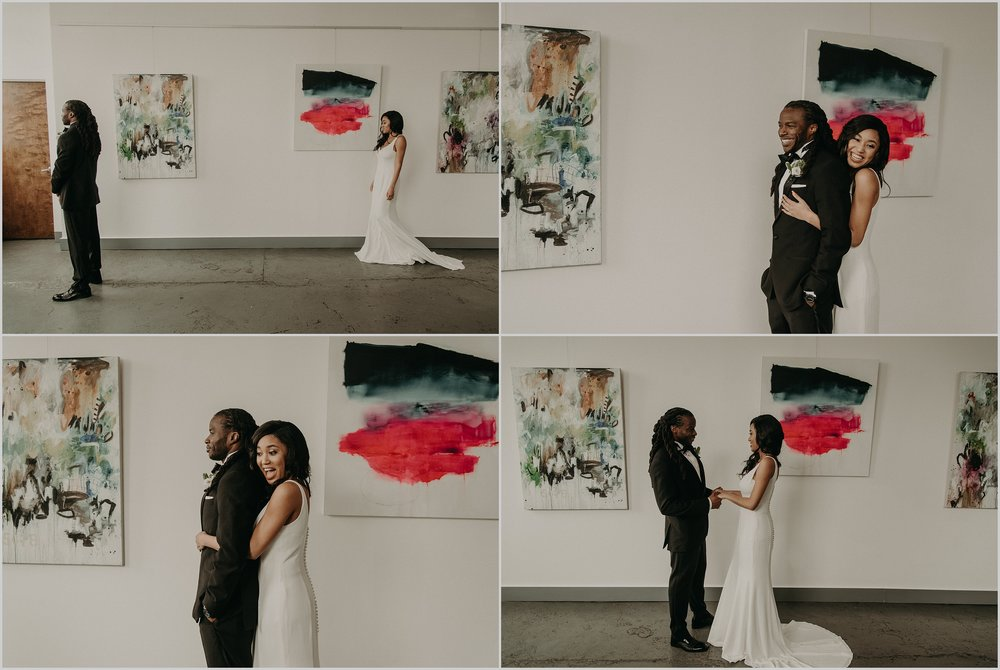 Bride and groom first look in this art gallery loft