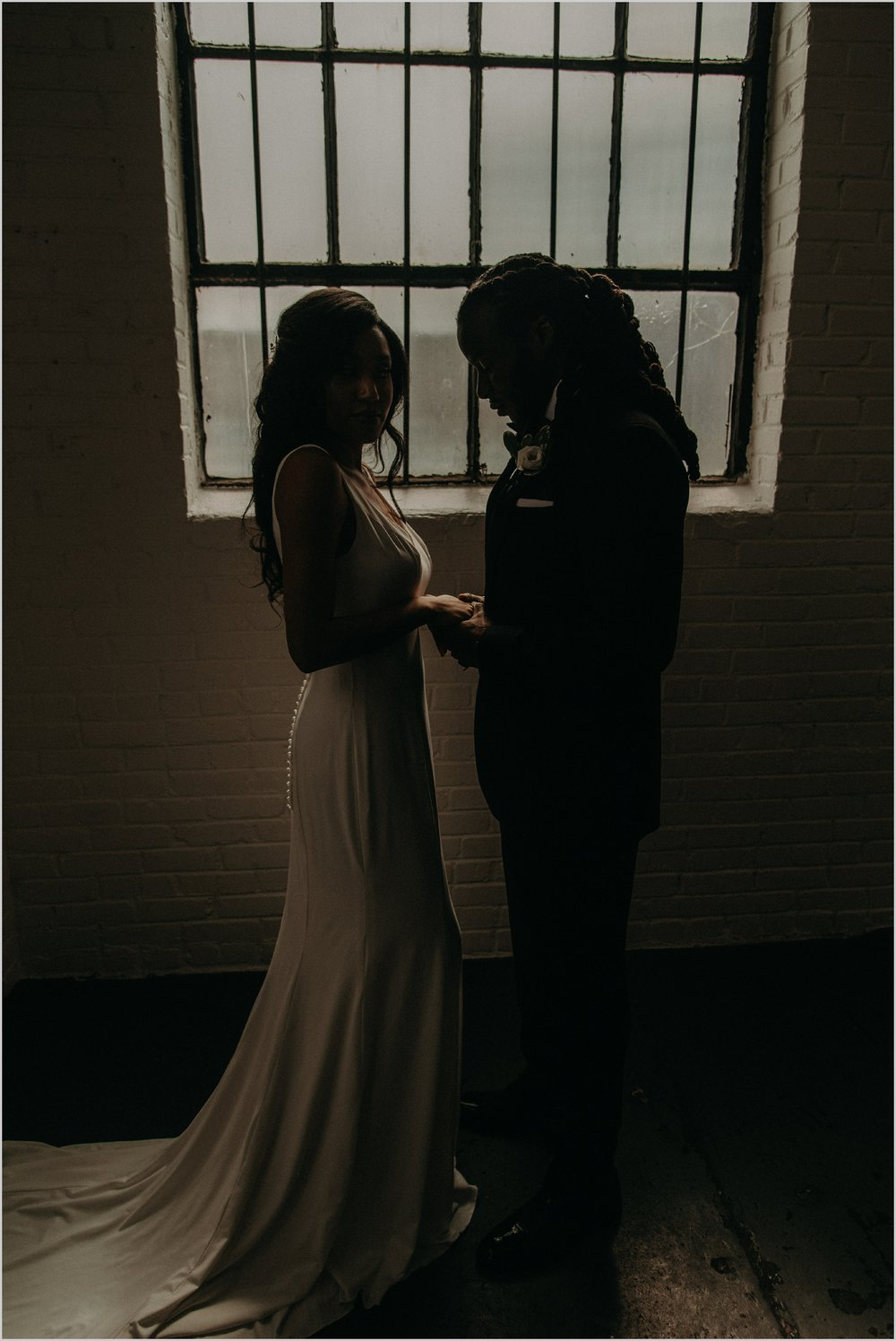 Unique wedding portraits inside Industrial White Loft