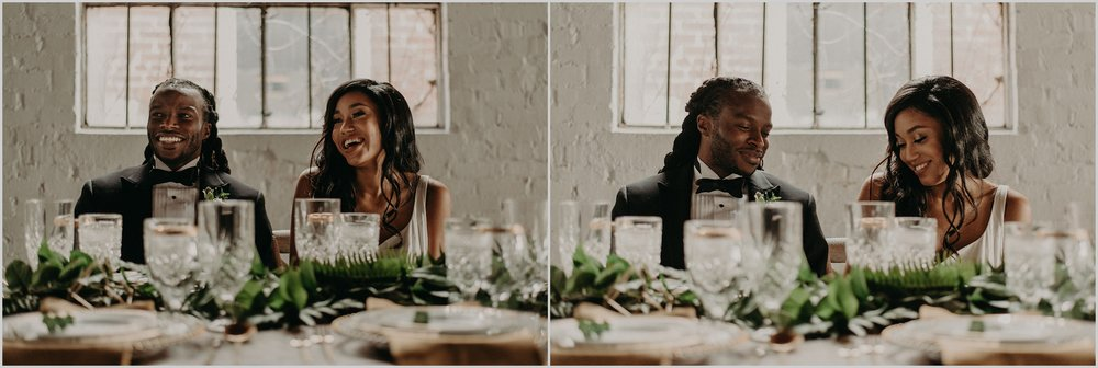 Wedding couple shares laugh at reception dinner