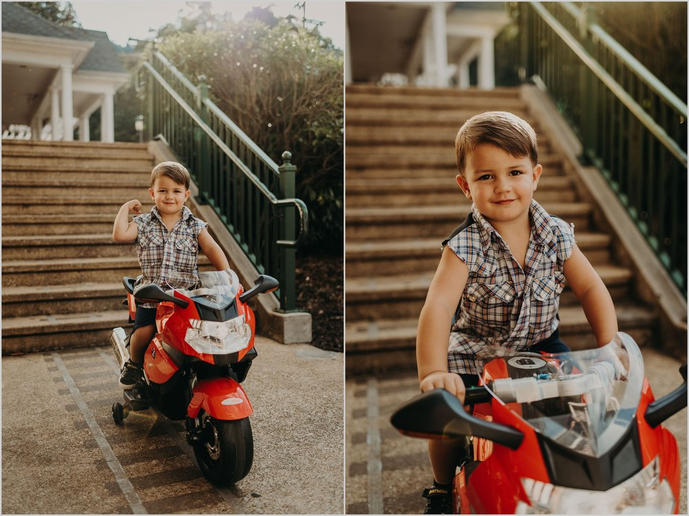 Young boy rides his toy motorcycle in historic St. Elmo