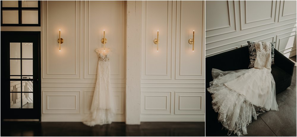 Modern industrial wedding venue with wedding gown hanging on wall