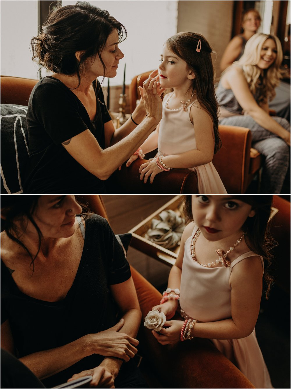 Mom applies lipstick on her daughter