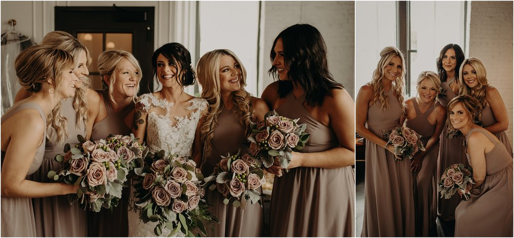 Bridesmaids laugh and hug before the ceremony
