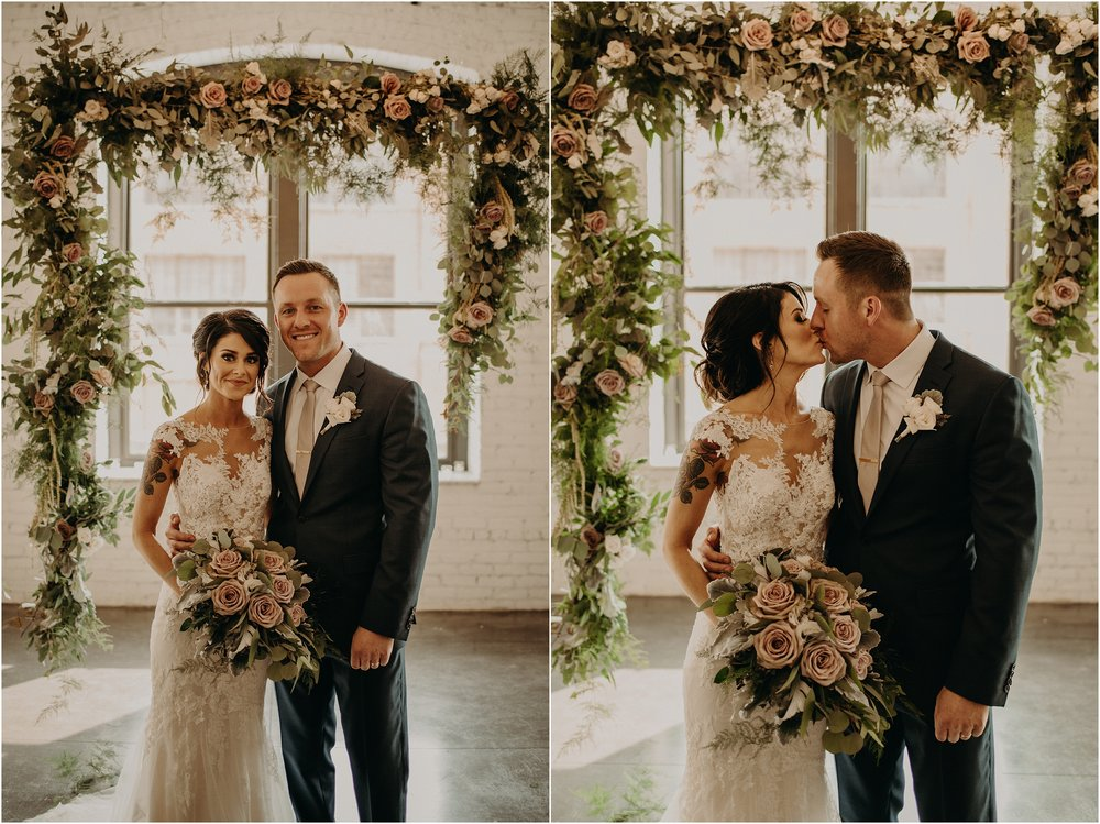 Bride and groom portraits beneath the Floral Wonders arch design