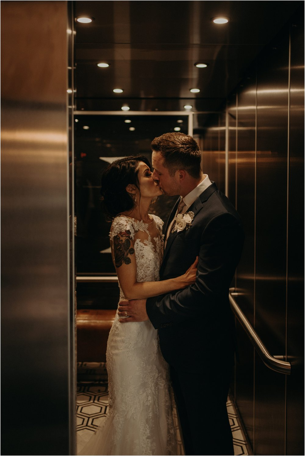 The couple steals a kiss in the uniquely designed Co. 251 elevator