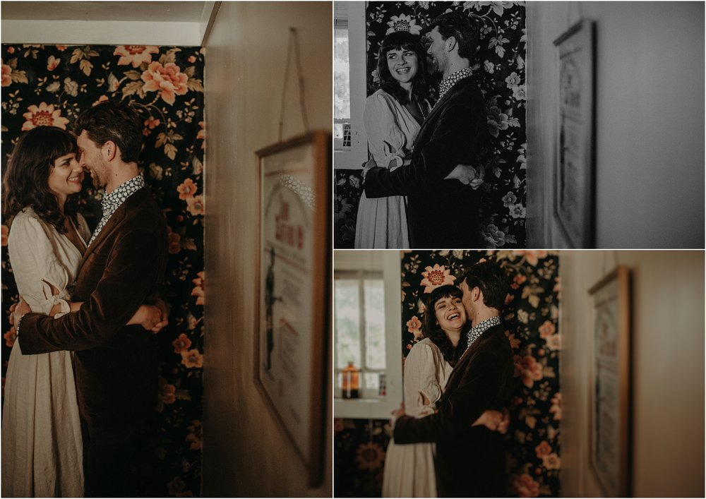 Bride and groom portraits in front of the fabric wallpaper in the kitchen of their Nashville cottage