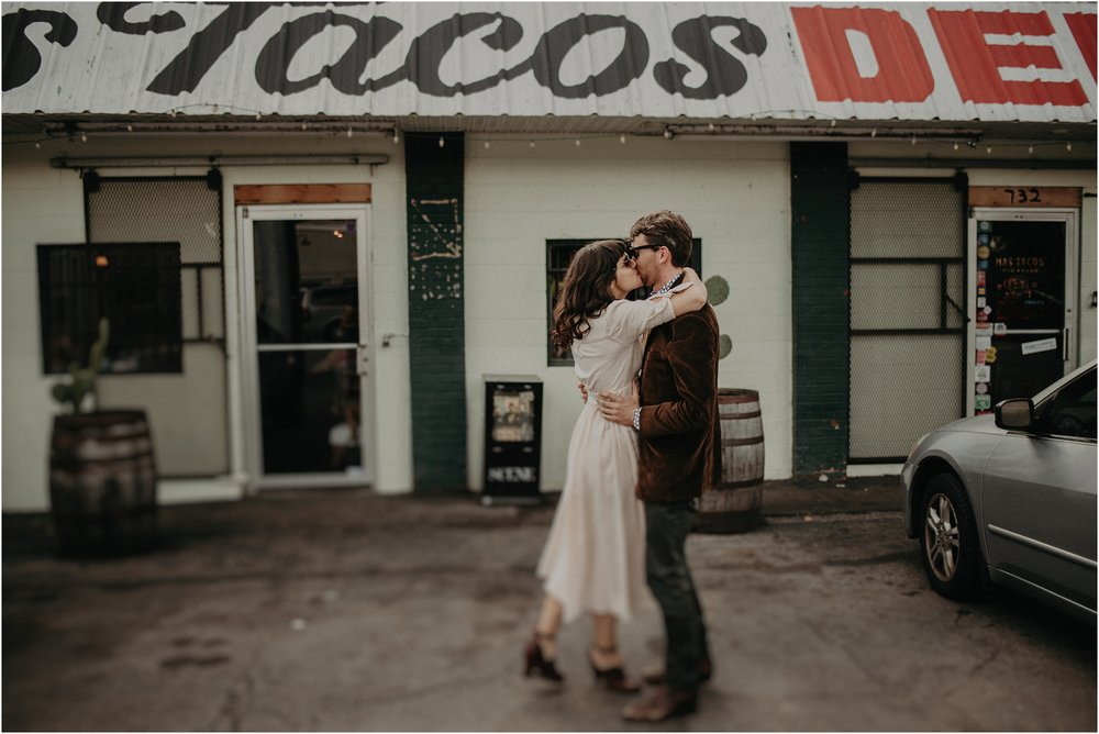 Sharing a celebratory kiss outside Mas Tacos during their reception