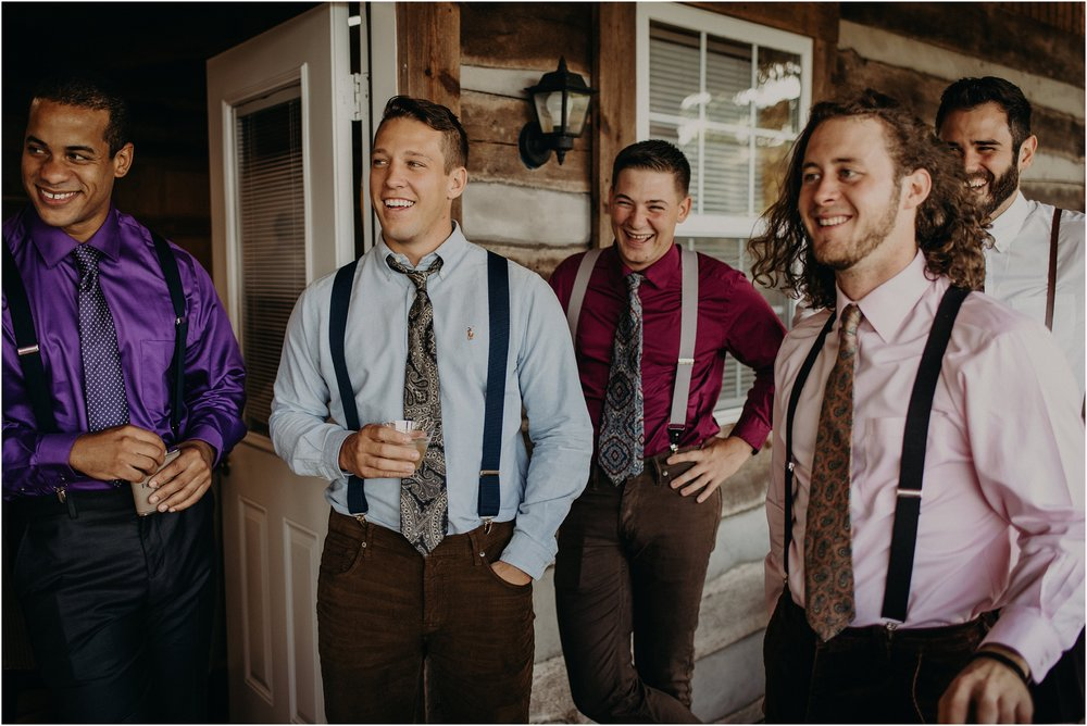 Groomsmen cheer on their groom