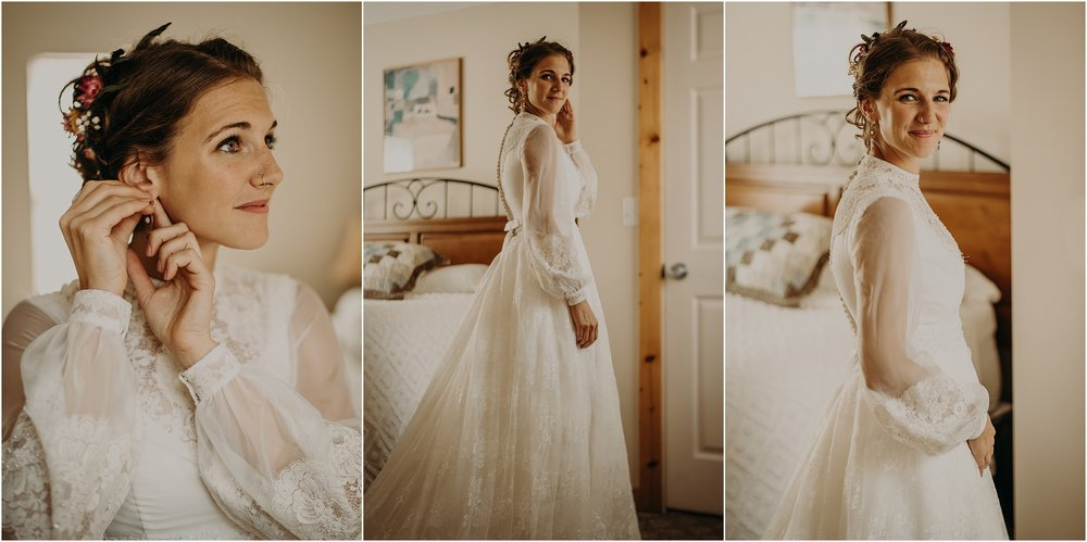 The bride poses in her vintage thrifted wedding gown