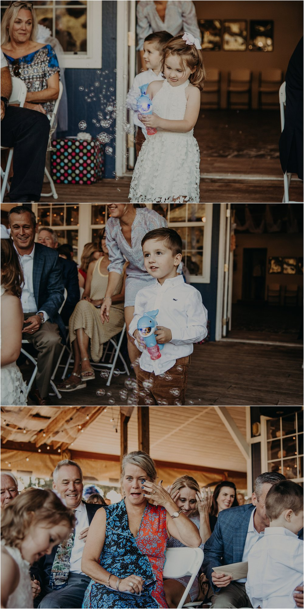 Ring bearer and flower girl blow bubbles as they walk down the aisle