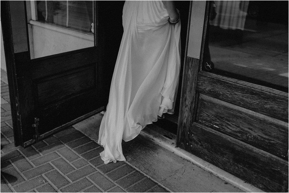 Dress detail as the bride enters St. John Restuarant