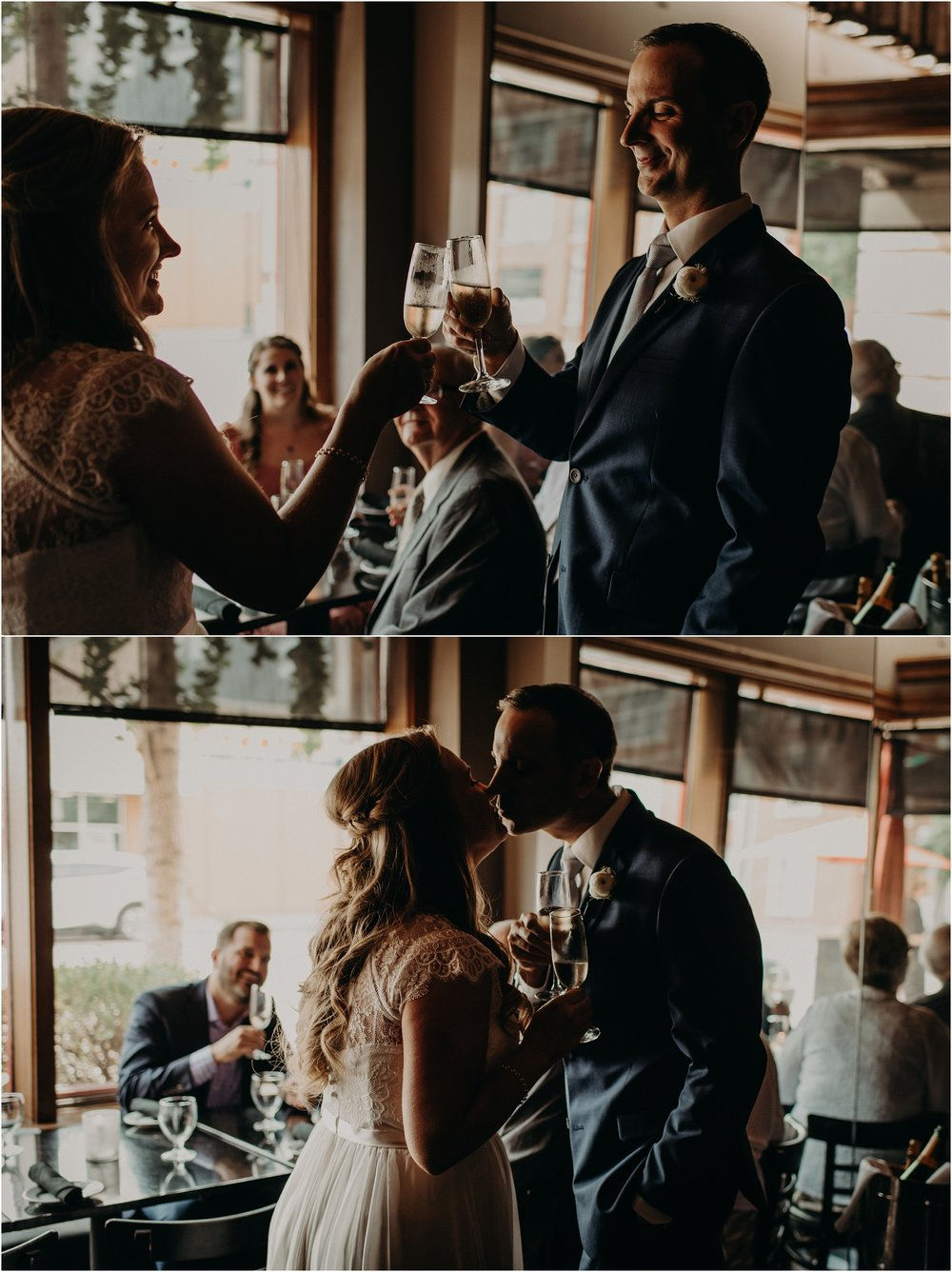 The couple shares a kiss after the clink champagne flutes