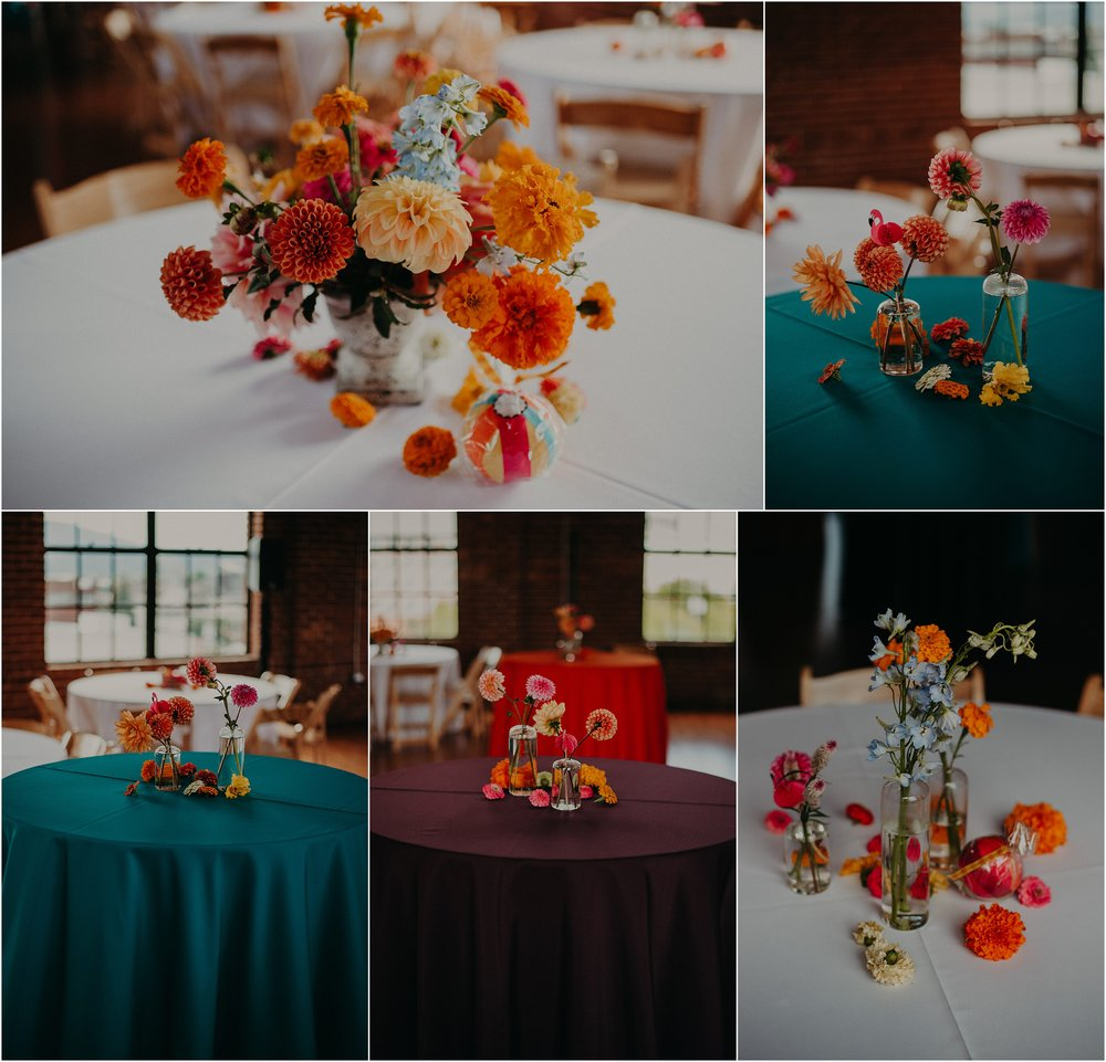 Vivid wedding table designs with jewel tone tablecloths and wild flower centerpieces