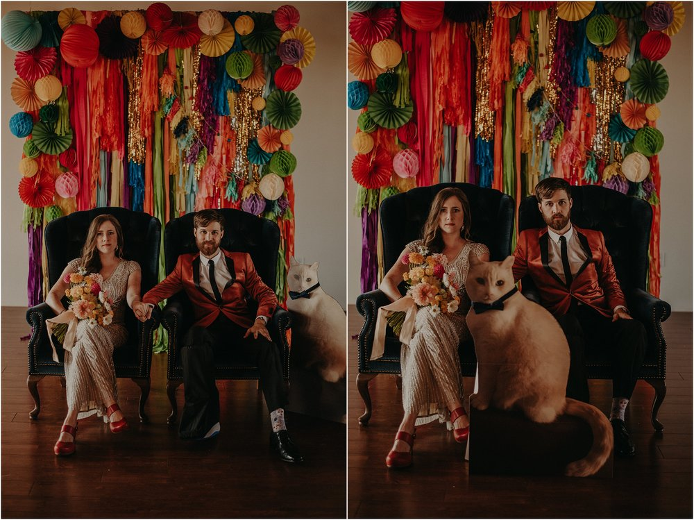 Quirky bride and groom portraits with a cardboard cut-out of their cat