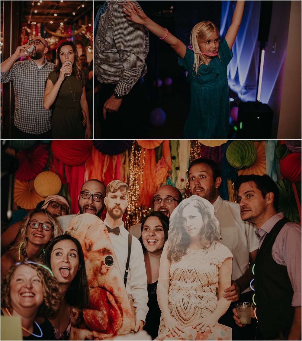 Guests pose with the life-size cardboard cut-outs of the bride and groom