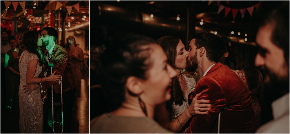 The newly married couple steals kisses during the reception chaos