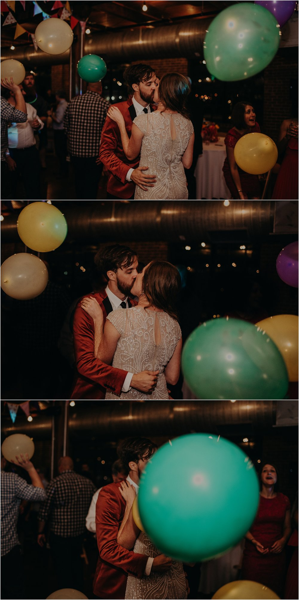 Balloons fall while the newlyweds kiss