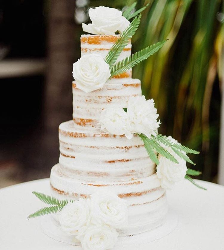 Simple Elegance. #Repost @brides ・・・ We've said it once and we'll say it again: Naked cakes for the win! This Miami-themed stunner (which was rosé champagne flavored 🍾) featured a soft pink hue on the inside 🍰 #BridesRealWedding | 📷: @merariteruel 🎂: @cloud9bakery 📋: @jcgevents 💐: @inesnaftalistudio 🏠: @theraleighhotel
