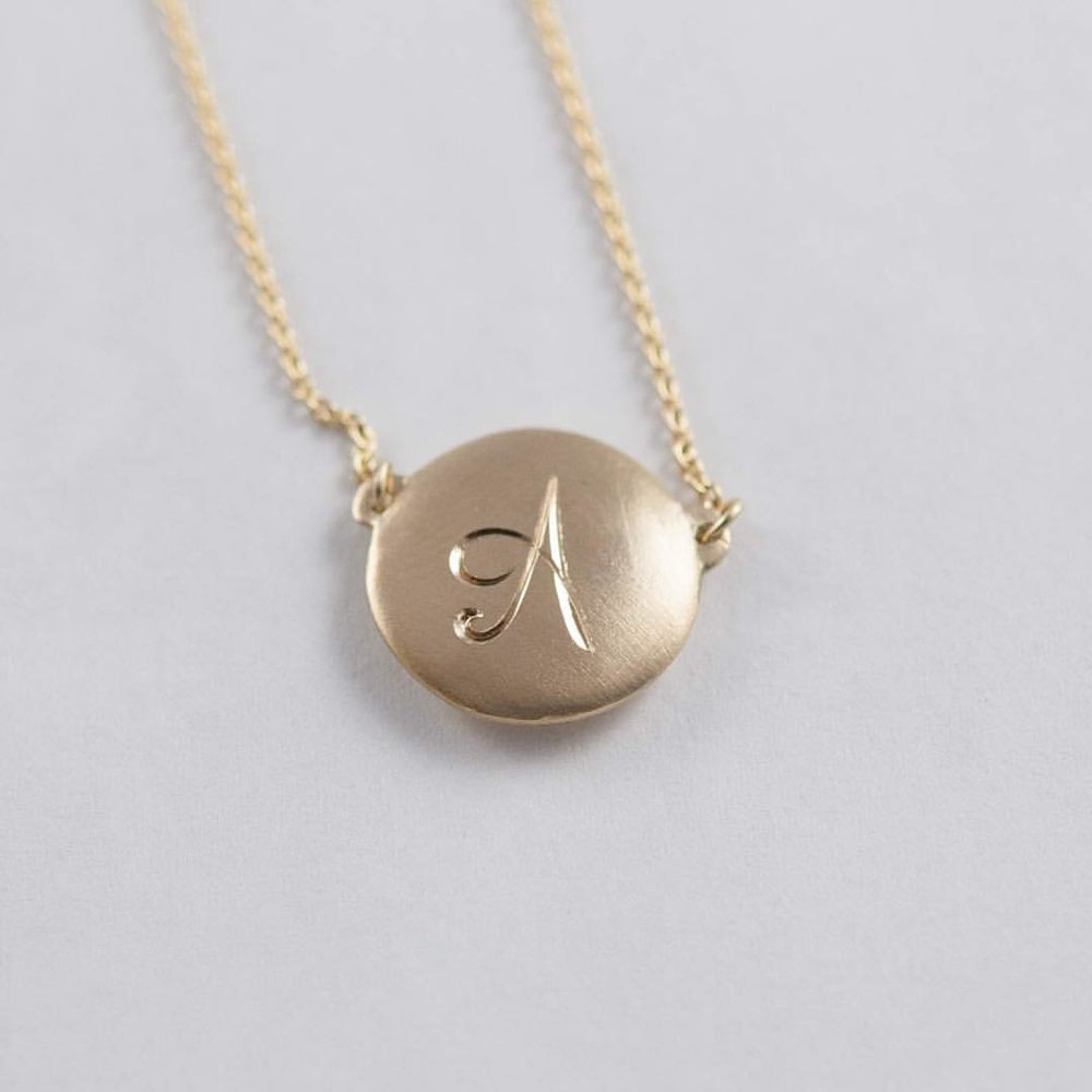 """What's in a Letter, A Name, A Symbol? Gift Ideas for Your Bridesmaids. The girls who have been there for you through thick and thin. Your Power Crew. Design something intimate for your girls. Find our engraveable pendants on the website under """"Shop"""". #charltonandlolaweddings #bridalinspiration #bridesmaids #bridesmaidsgifts #weddingplanning #clique #girlsquad #bestfriends #munabling #dreamweddings #weddingdetails #personal (at New York, New York)"""
