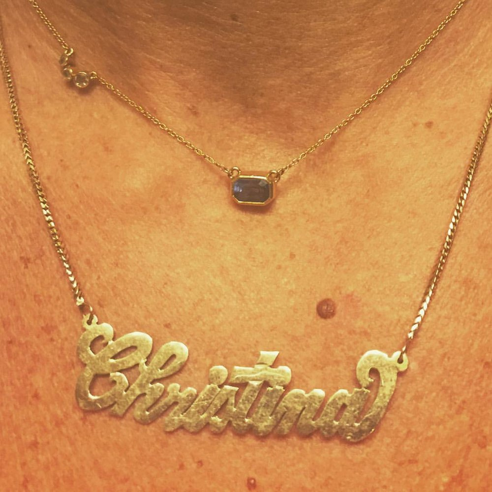 """That's Tina For You. Her #charltonandlola sapphire necklace with her old school """"Carrie Bradshaw"""" type name plate necklace. #stackgameisstrong #necklacestack #oldiebutgoodie #namegame #sapphire #september #SATCvibe #swag (at New York, New York)"""
