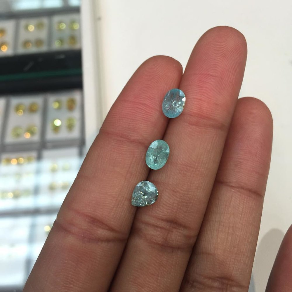 """Good morning! To all the lovely people that have asked, these are the Paraiba stones that are left under a carat. Email or DM if interested. The price is pretty awesome! Also, time to talk about stone selection and my process. Question: how do I pick or select the stones I show? Some of you know and some people don't know, but I pick my stones based on their energy. I'm a certified reiki master and specialize in studying rocks and stones, which include crystals. So I only pick and show your stones that I feel are vibrant and have some kinda life to them besides just being """"gem quality"""". I believe there are enough brands that have covered that luxe space, so you don't need me to join the party. I will spend hours on West 47th looking for gems and I will be offered stones to select and buy as well. I will only show you stones with magic in them: light, color, play, fire, water…So if I wouldn't buy it for myself. I wouldn't show it to you. Those who follow me on #Instagramstories now my rock obsession is real. Lol. Feel free to DM me if you have more thoughts and questions about stones! I love talking about it. Love, Lisa #musingsbylola #charltonandlola (at New York, New York)"""