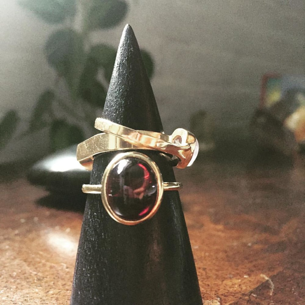 """Blood Red."" On the website right now. Asha Ring. Asha means Life. What more can we ask for? Fall in love with the our blood red cabochon rings. Link above 👆🏿#charltonandlola #lovegold #garnet #pinkyrings #stackingrings #stacking #everydaystyle #transformation #oprah #goodwitch #newmoon #shoplocal #newyorkcity #shopitnow (at New York, New York)"