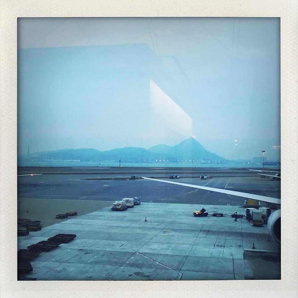 In a land far far away. 15hrs later. Sometime into the future. Monday. (at Hong Kong International Airport)
