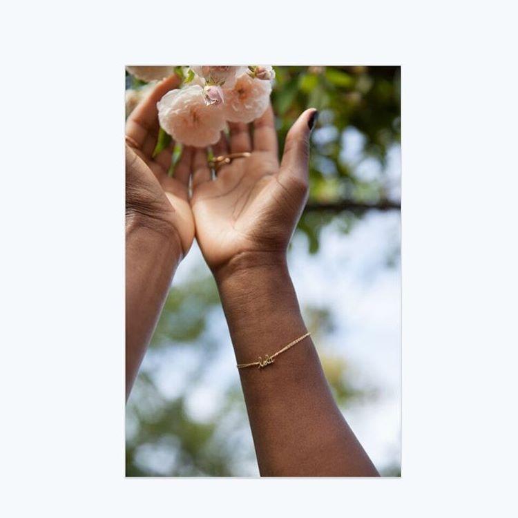 """Easy Beautiful"". The name/mantra gold chain bracelet. Be creative. What are your words? Email info@charltonandlola.com. (Credit: @yukineophoto #charltonandlola #madeinnyc #lovegold #roses #instajewelry"