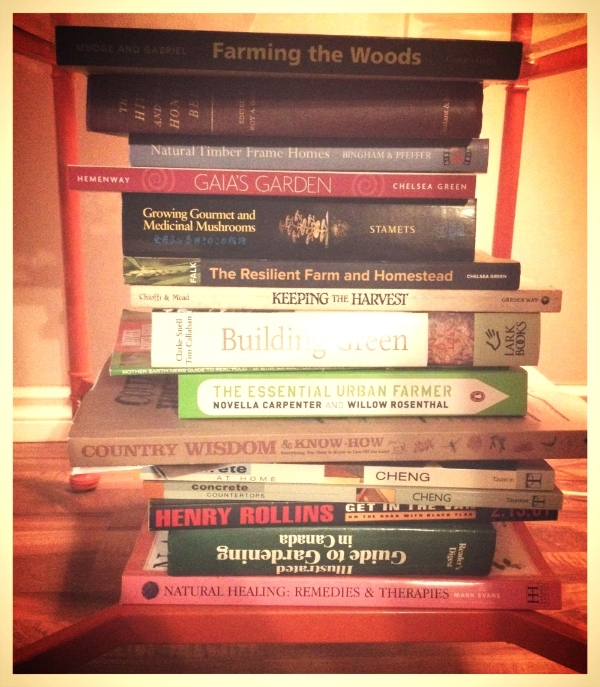 Our homesteading library, complete with many books we have and have not read