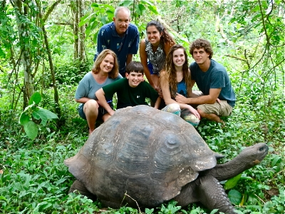 Lou and Rob with their family and a famous Galapagos tortoise in the highlands of Santa Cruz.