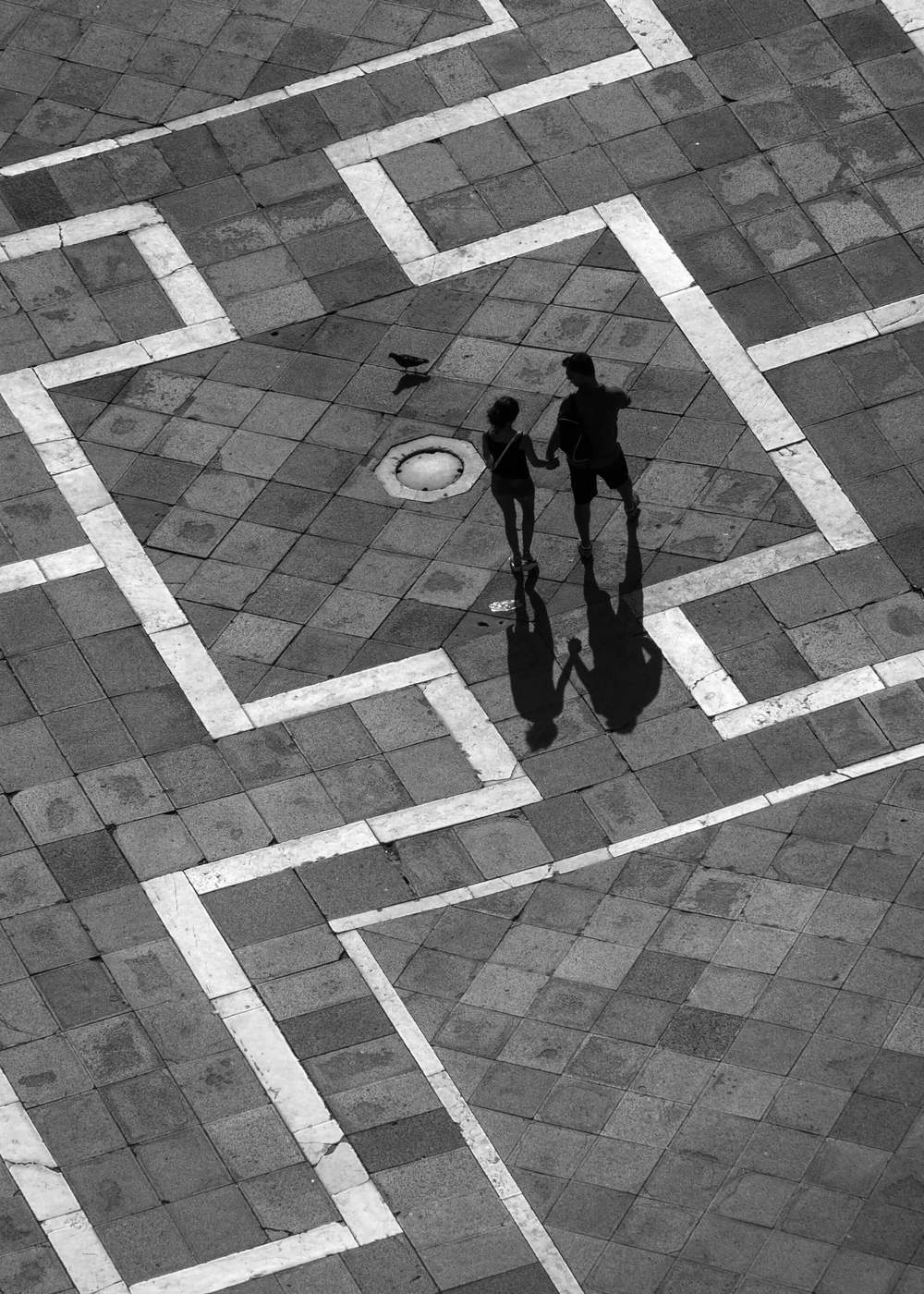 A photograph of a couple taken at San Marco square in Venice