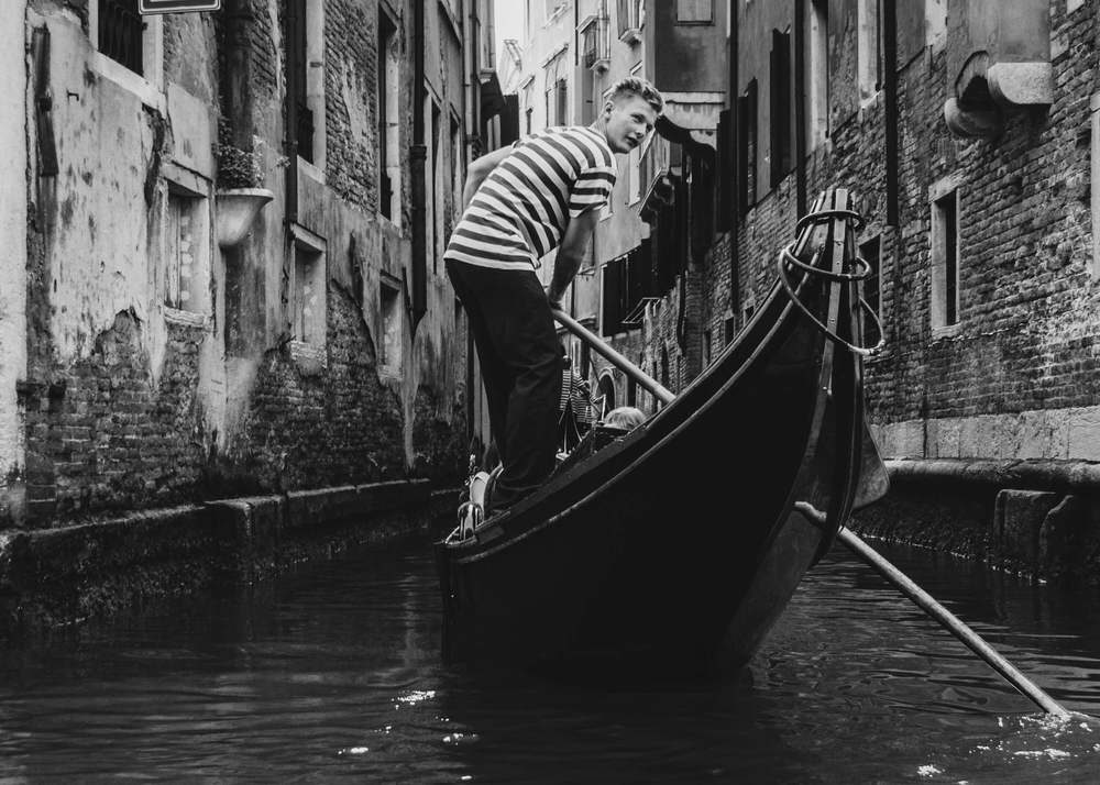 A photograph of a young Gondolier taken in Venice
