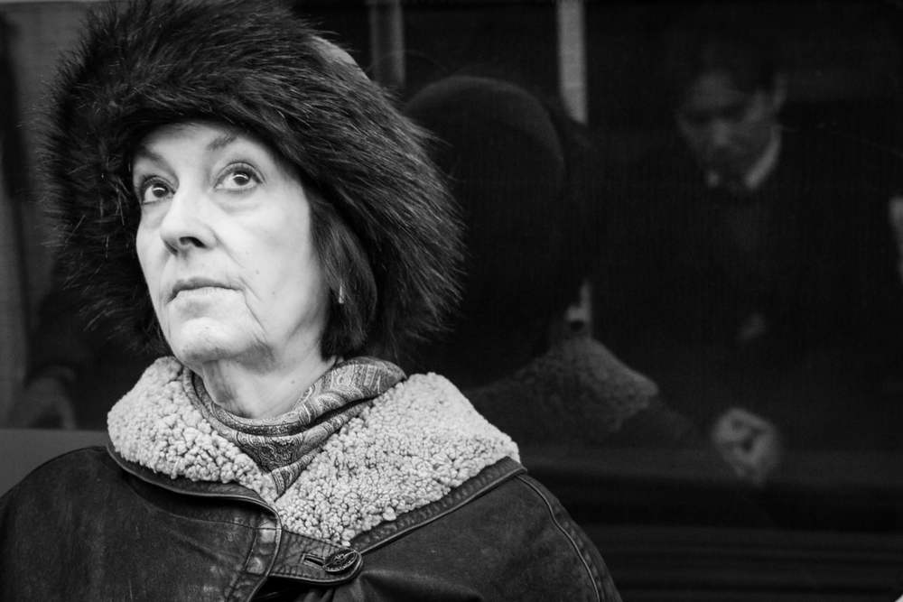A photograph of an lady taken on the London Underground