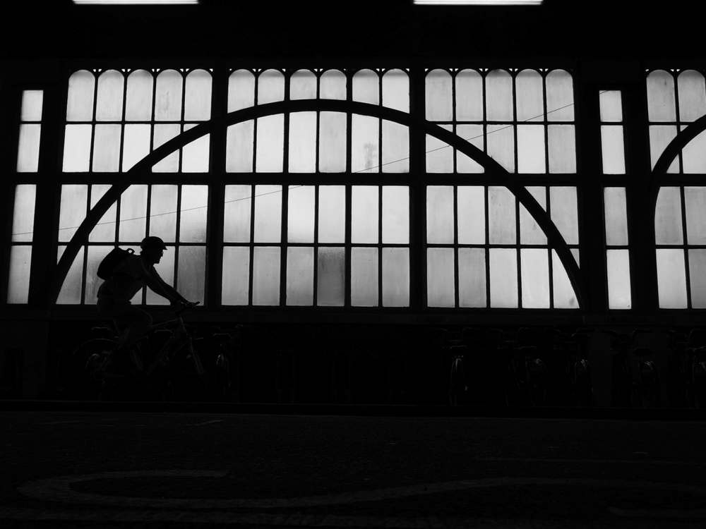 A 4Kphoto silhouette of a cyclist taken just outside the London Waterloo station using LUMIX G7